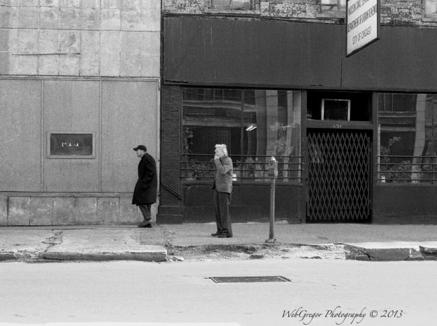 Two men walking Madison Street