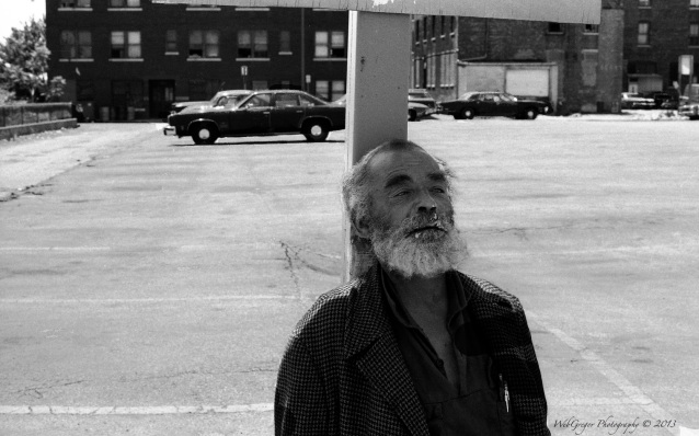 Man Sitting in a Parking Lot