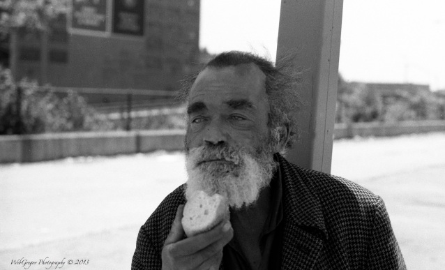 Man Eating a Piece of Bread