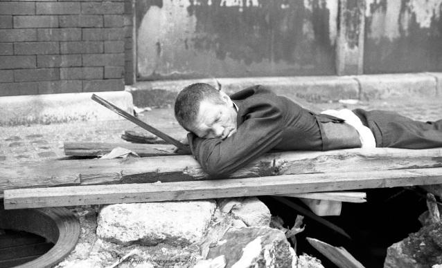 Man Sleeping Outside on Sidewalk ~ Close-up