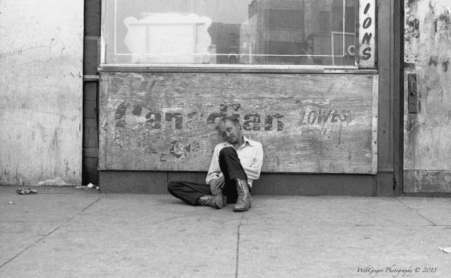 Man Sitting Outside a Bar